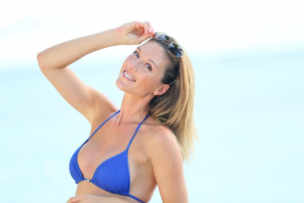 Attractive mature woman in blue bikini