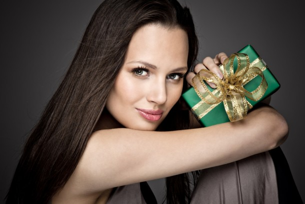 Beautiful woman with wrapped Christmas gift