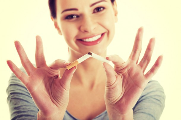 Attractive woman breaking cigarette