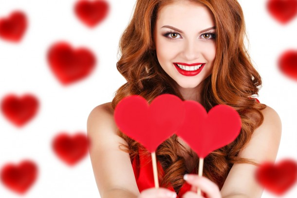 Beautiful red haired woman with Valentine's Day hearts